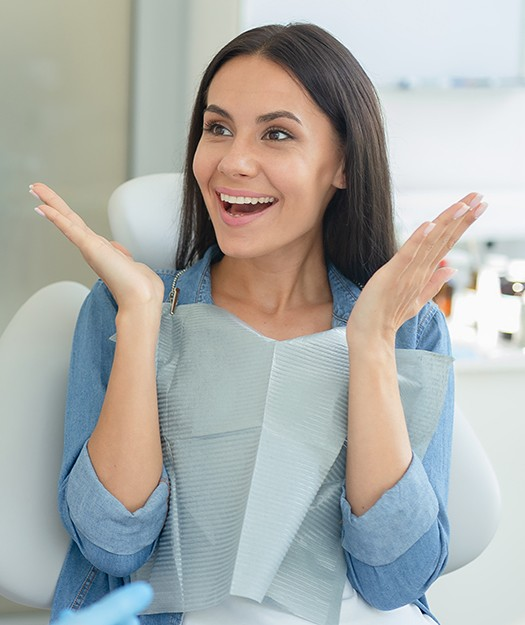 Woman showing off smile after cosmetic dentistry