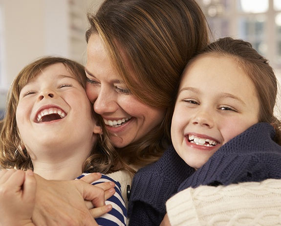 Mother and two children laughing together