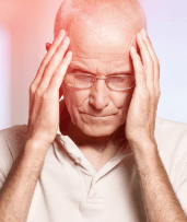 Man holding head with jaw joint pain and headaches