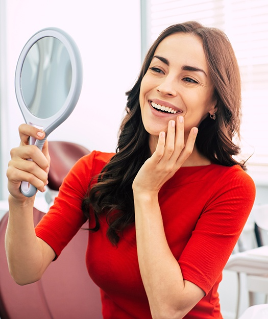 Woman looking at healthy smile after dental checkups